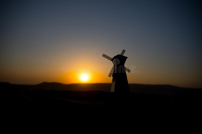 Traditional, Dutch windmill at a hill during a summer sunset. Decoration. Selective focus royalty free stock photo