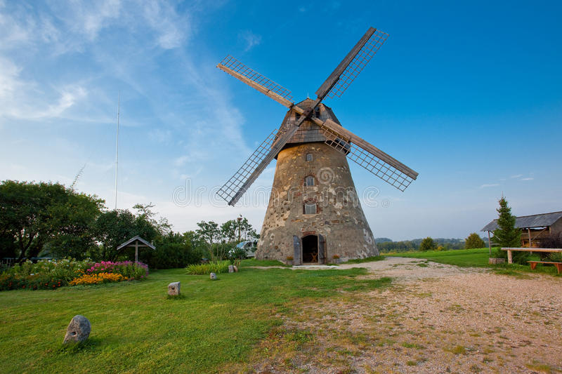 Traditional dutch windmill in Latvia stock images
