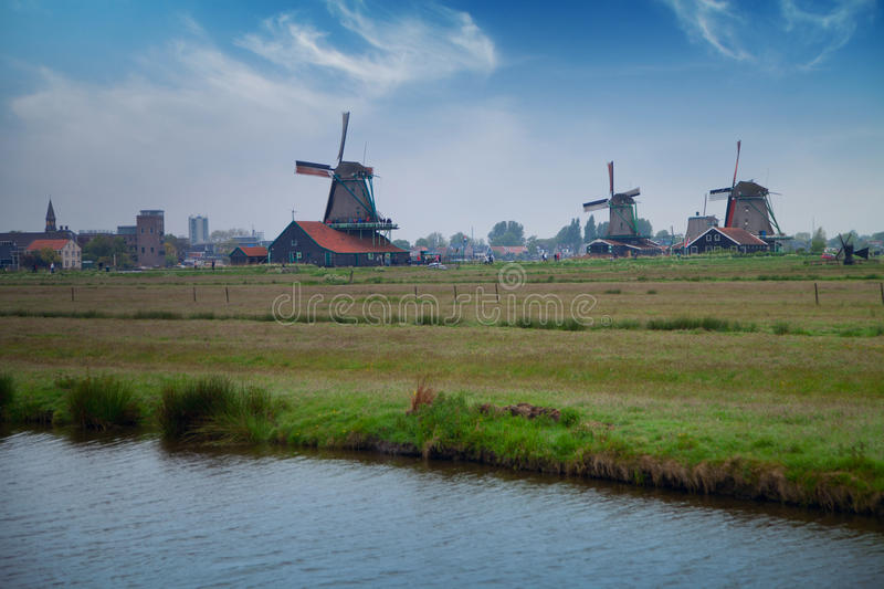 Traditional Dutch windmills with canal near the Amsterdam stock image