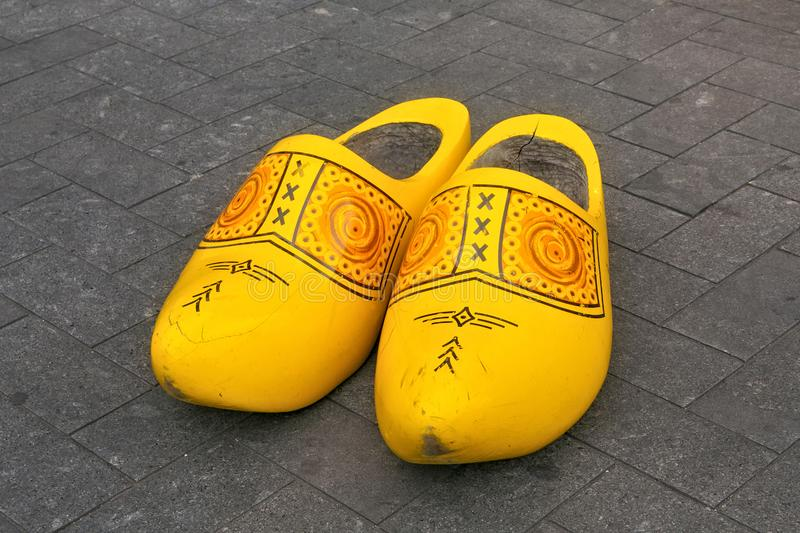 Traditional Dutch wooden big klomps shoes also known as clogs or klompen. royalty free stock photography