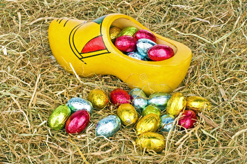 Traditional dutch wooden clog with little colored easter eggs royalty free stock photos