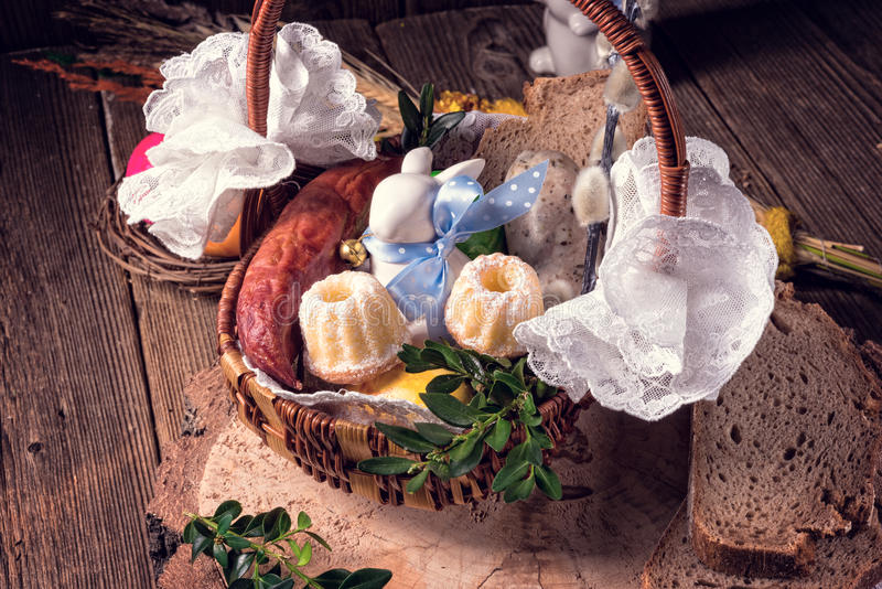 Traditional Easter basket with food. A Traditional Easter basket with food royalty free stock photo