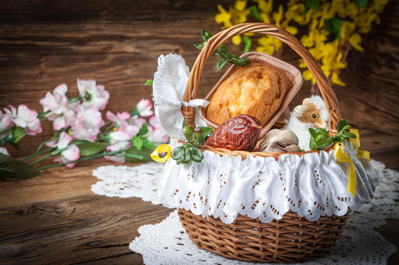 Traditional Easter basket with food. Traditional Easter basket with food on the wooden table stock photography