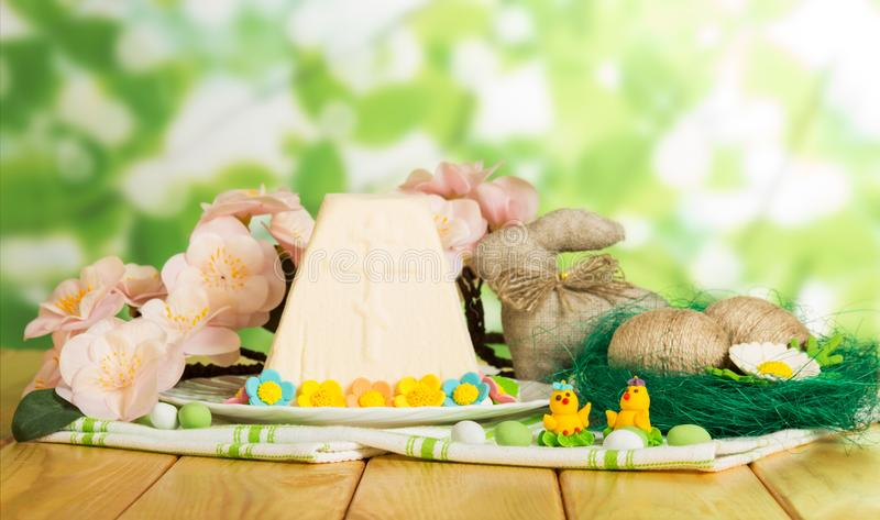 Traditional Easter cheese dessert, Easter eggs, Bunny, toy chick royalty free stock photography