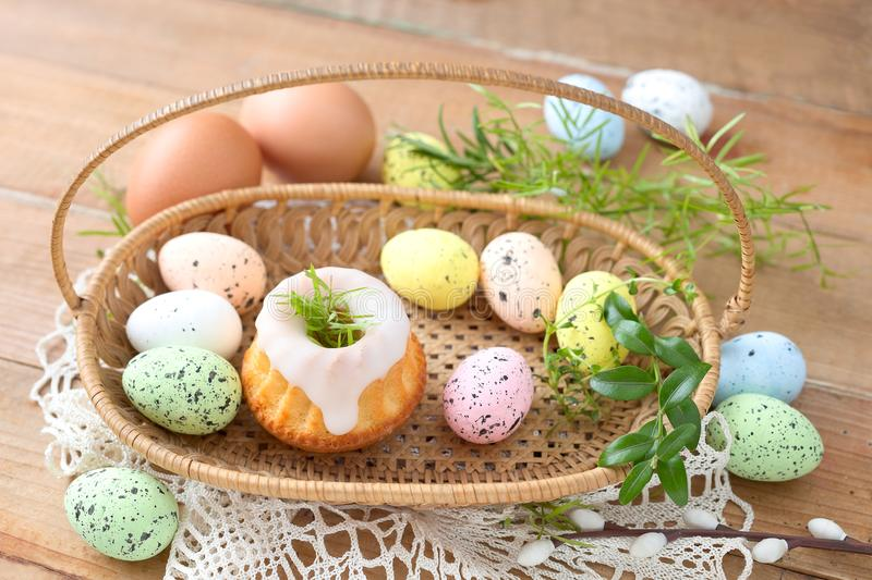 Easter food. Traditional Easter food: cake and eggs in a basket royalty free stock photography