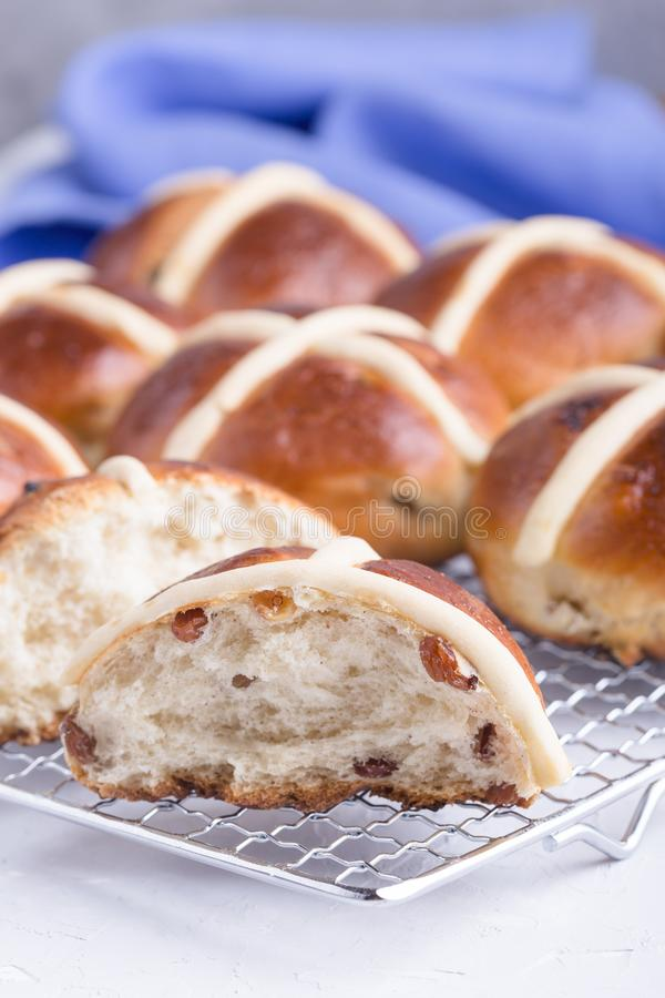 Easter hot cross buns on light background. Traditional Easter hot cross buns on holiday table on light background stock photos