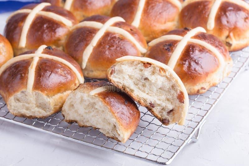 Easter hot cross buns on light background. Traditional Easter hot cross buns on holiday table on light background stock images
