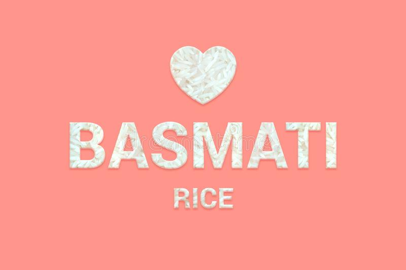 Traditional Eastern Basmati rice texture text. Vegan, Vegetarian Super food and detox food. Traditional Eastern Basmati rice texture text with heart shape on royalty free stock photography