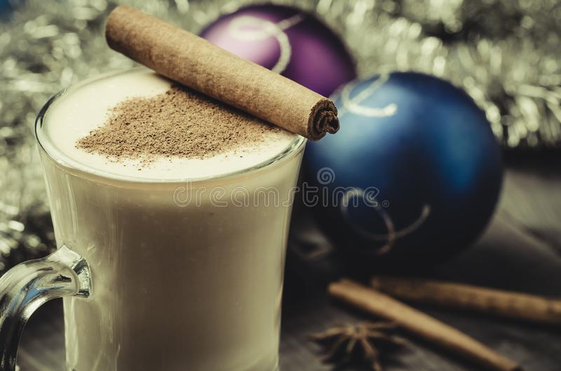 Traditional eggnog in a glass and christmas decoration/Traditional eggnog in a glass and christmas decoration. Selective focus royalty free stock photos