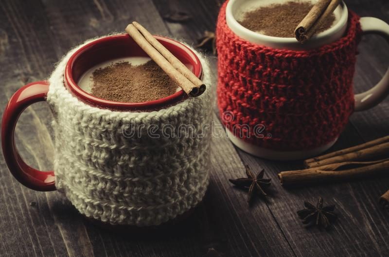 Traditional eggnog in red and white mugs/traditional eggnog in r stock photography