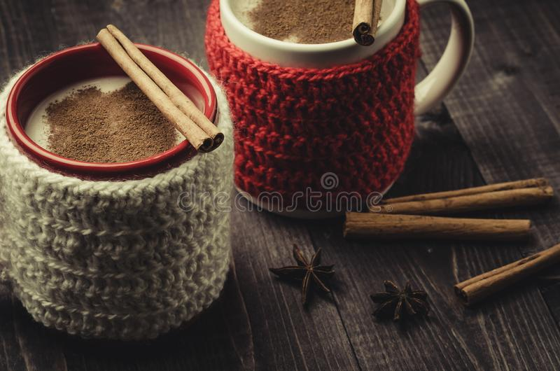 traditional eggnog in red and white mugs/traditional eggnog in red and white mugs on a wooden dark background royalty free stock images