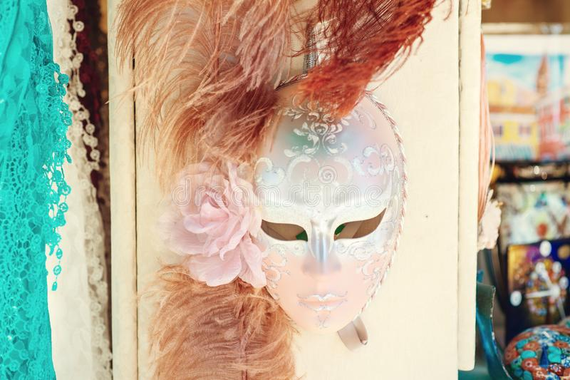Traditional venetian mask in store on street, Venice Italy. stock image