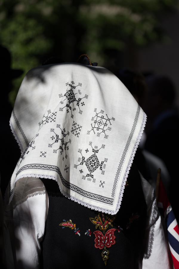 Traditional embroidered headscarf worn on the Norwegian Constitution Day, National Holiday. Oslo, Norway - May 17, 2016: traditional embroidered headscarf worn stock image