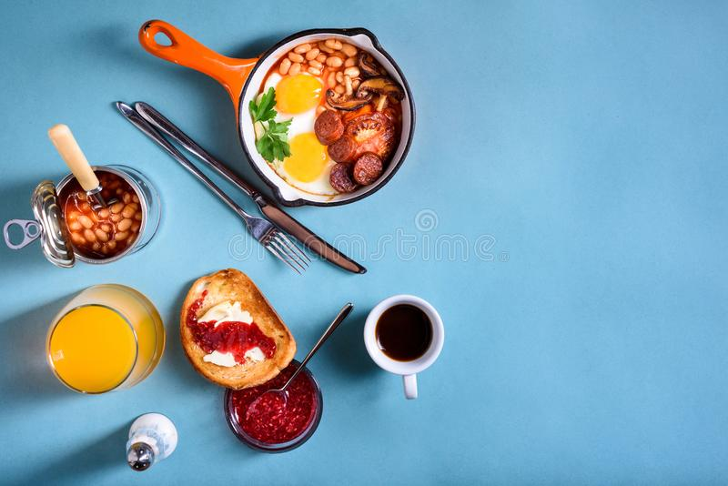 Traditional English Breakfast Food on the table eggs, coffee, to. Traditional English Breakfast Food on the table eggs ,sausages, beans, coffee and orange juice stock photography