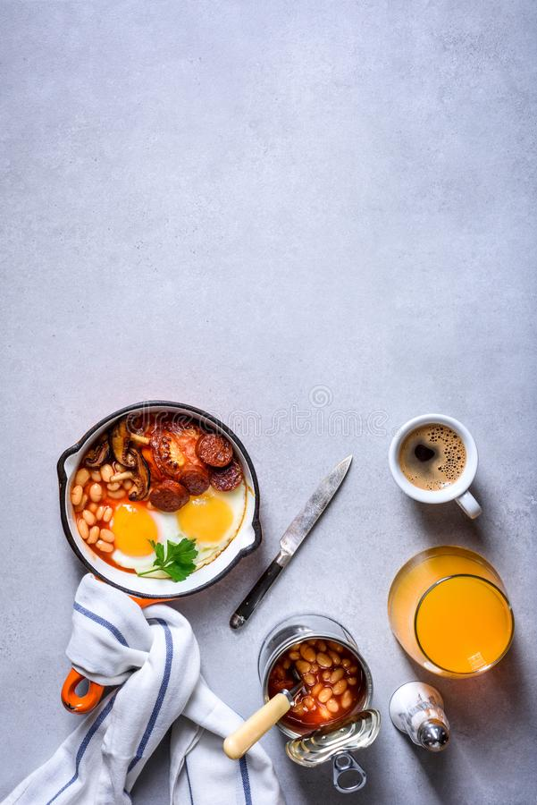Traditional English Breakfast Food on the table eggs ,sausages,. Beans, coffee and orange juice Top View, flat lay stock photos