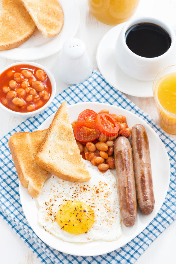 Traditional English breakfast with sausages, top view stock image