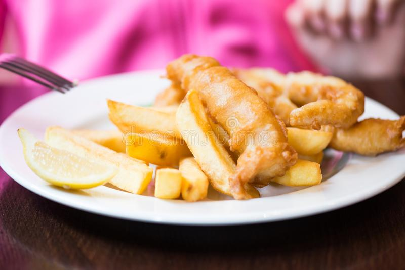 Traditional English Food such as Fish and Chips. With green peas served in the Pub or Restaurant stock photography