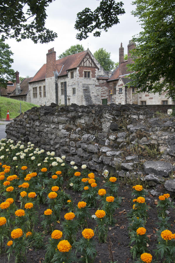 Traditional English house with a flower garden in front stock image