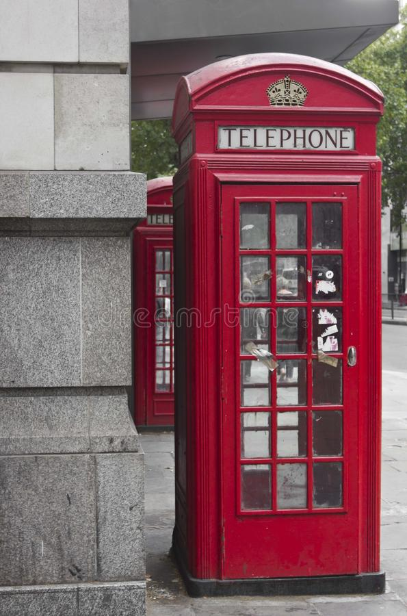 Traditional English Red phone box. LONDON, UNITED KINGDOM - SEPTEMBER 12 2015: Traditional English Red phone box in the street royalty free stock photos