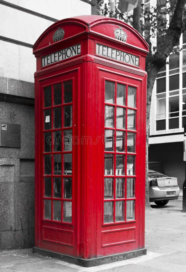 Traditional English Red phone box in the street. LONDON, UNITED KINGDOM - SEPTEMBER 12 2015: Traditional English Red phone box in the street royalty free stock images