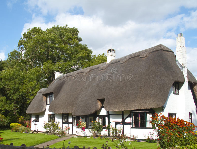 Traditional English Thatched Cottage stock photo