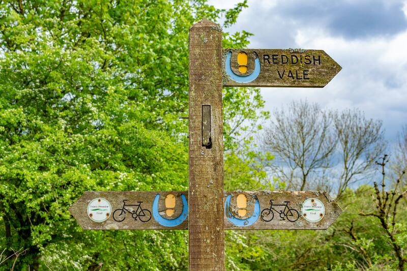 Traditional English wooden public footpath/bridleway/cycleway sign in countryside, Cheshire, UK. Traditional English wooden public footpath/bridleway/cycleway royalty free stock image