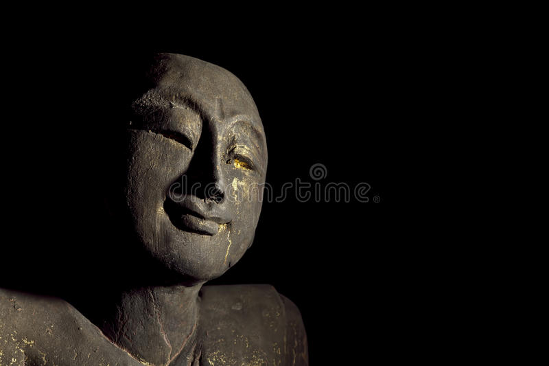 Traditional Enlightened Buddhist Monk Statue. Traditional carved statue of an enlightened buddhist monk stock photography