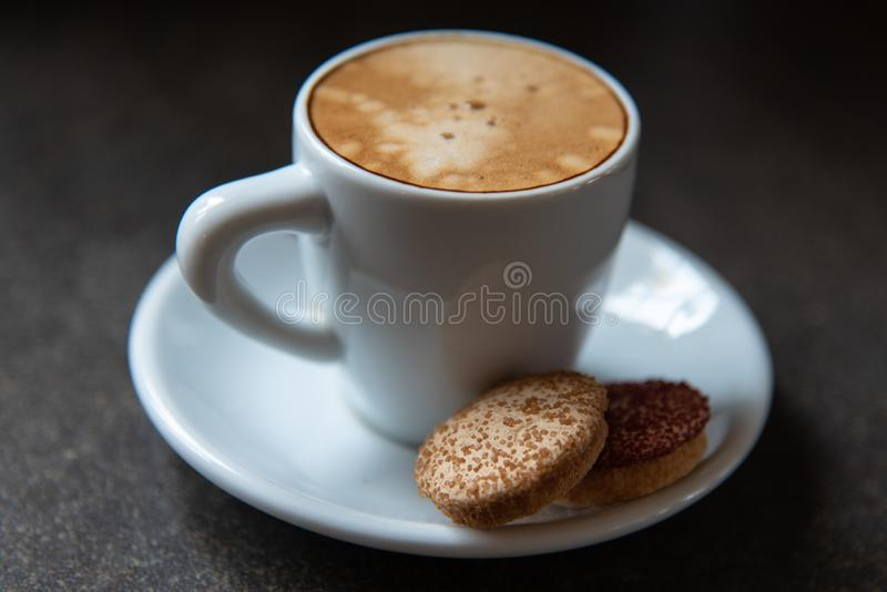 Traditional espresso lungo with biscotti stock photography