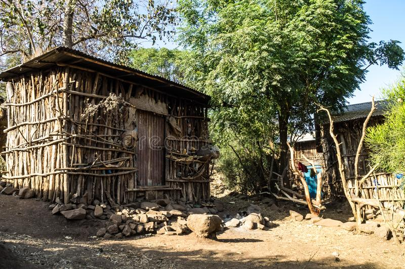 Landscape view near the Blue Nile falls, Tis-Isat in Ethiopia, Africa. Traditional Ethiopian Hut near the Blue Nile falls, Tis-Isat Falls, meaning great smoke in stock images
