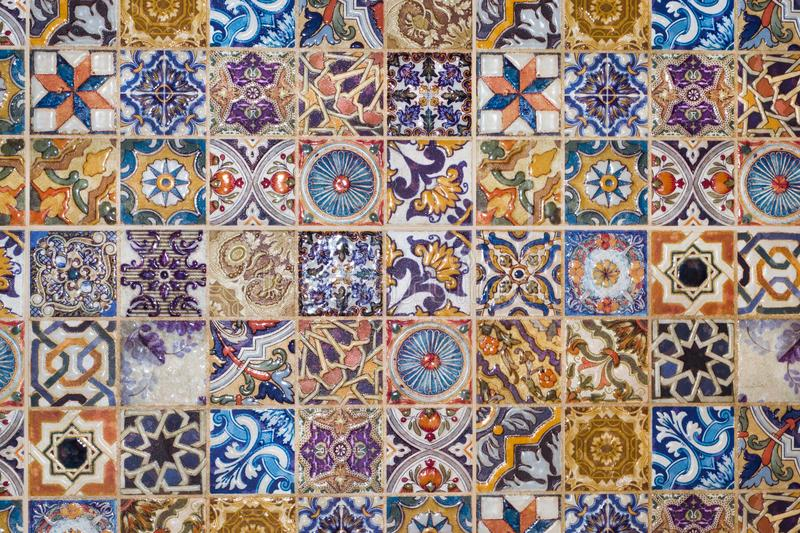 Traditional European ceramic mosaic tile pattern. Checkered traditional European ceramic mosaic tile background pattern. Architectural mosaic detail, abstract royalty free stock photos