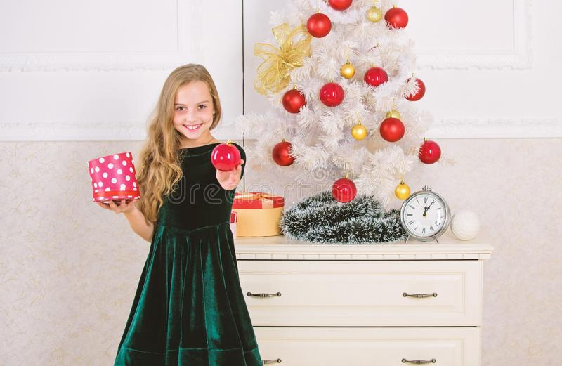 Traditional family holiday. Kid girl near christmas tree hold gift box. Child celebrate christmas at home. Favorite day. Of the year. Time to open christmas stock photos