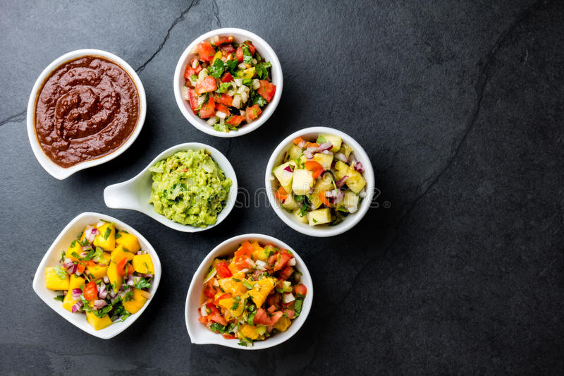 Traditional famous mexican sauces chocolate chili mole poblano, pico de gallo, avocado guacamole, salsa bandera, pinapple salsa, m stock photos