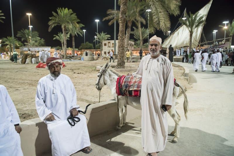 Man and donkey at festival Oman royalty free stock photography