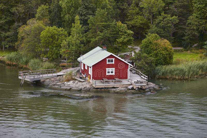 Traditional finnish red wooden house. Lake shore. Finland royalty free stock images