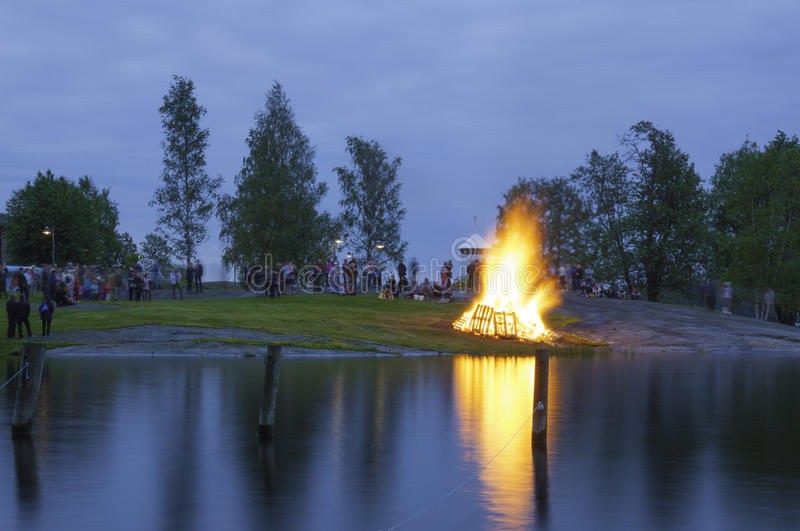 Traditional Finnish summer solstice bonfire. Savonlinna, Finland. June 19, 2015: Bonfire burning during summer solstice celebrations in Riihisaari, Savonlinna royalty free stock images