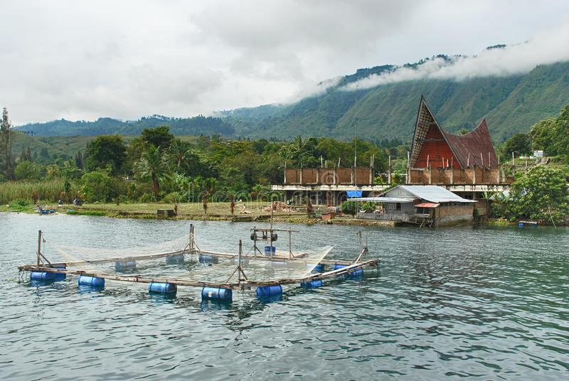 Traditional fish cage on Danau Toba Lake, Medan, Indonesia. With moutain background covered with clouds stock images