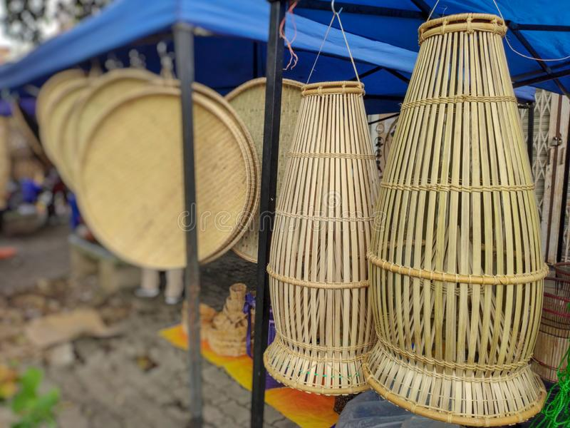 Traditional fish trap made of bamboo and rattan sale on marketplace located in Sabah, Malaysia. Bornean fish trap made of bamboo and rattan sale on marketplace stock image