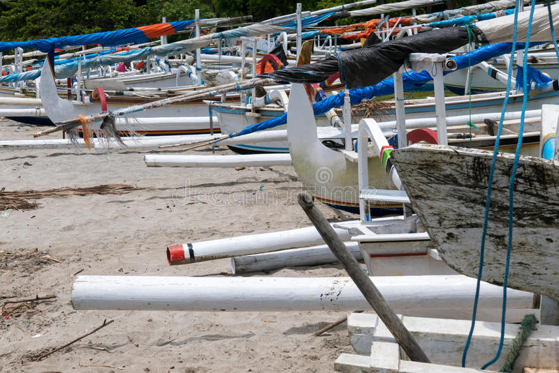 Traditional fisher boats at beautiful Candidasa beach in Bali, I royalty free stock photo
