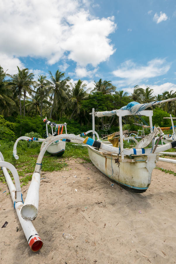 Traditional fisher boats at beautiful Candidasa beach in Bali, I stock images