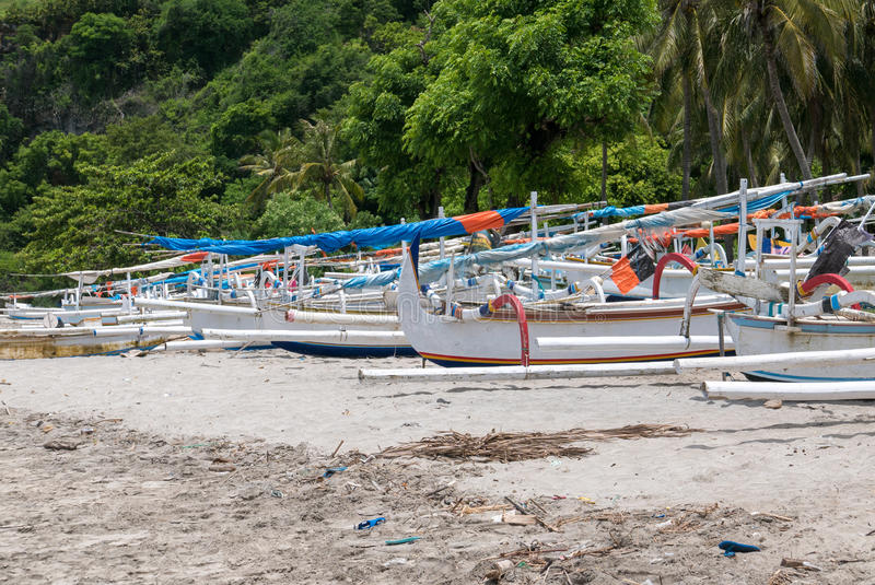 Traditional fisher boats at beautiful Candidasa beach in Bali, I stock photography