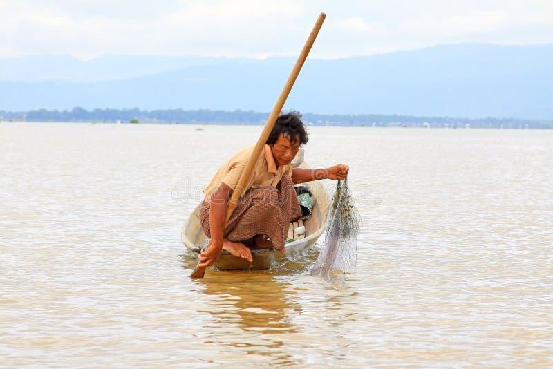 Traditional Fisherman, Inle Lake, Myanmar. Fisherman One Leg Paddling in Inle Lake Myanmar royalty free stock photography