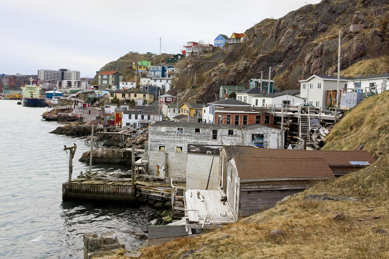 Traditional fishermen's houses on the ocean. Panorama of traditional colorful fishermen owned houses along the coast in St. John's Newfoundland stock photography