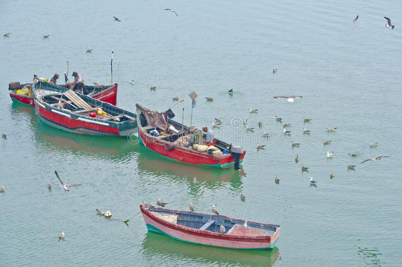 Traditional fishermen at work, Morocco, fishing from small wooden boats stock photos