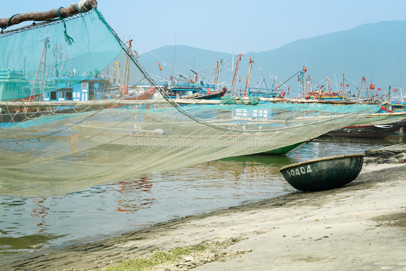 Traditional Fishing Boat with Net and Woven Bamboo Basket Boat At The Fishing Village in Da Nang, Vietnam stock photos