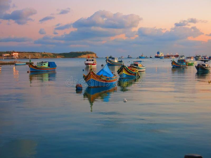Traditional fishing boats at harbor of Marsaxlokk stock images
