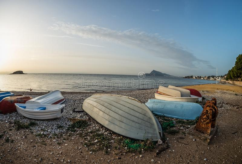 Fishing boats on Altea bay. Traditional fishing boats towed ashore with vintage machinery on Altea Bay, Costa Blanca, Spain royalty free stock photo