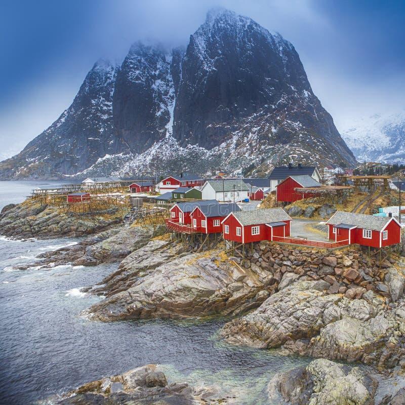 Traditional Fishing Hut Village in Hamnoy Mountain Peak in Lofoten Islands, Norway stock photo