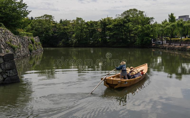 Traditional float with a group of Tourists and Guide in the Inner Moat of Himeji Castle. Himeji, Hyogo, Japan, Asia stock photography