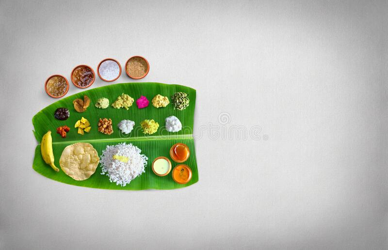 Traditional food Onam Sadya served on a banana leaf on Festival day onam,  Vegetarian meal with rice and curries, kerala food, Ker. Ala, india stock photography
