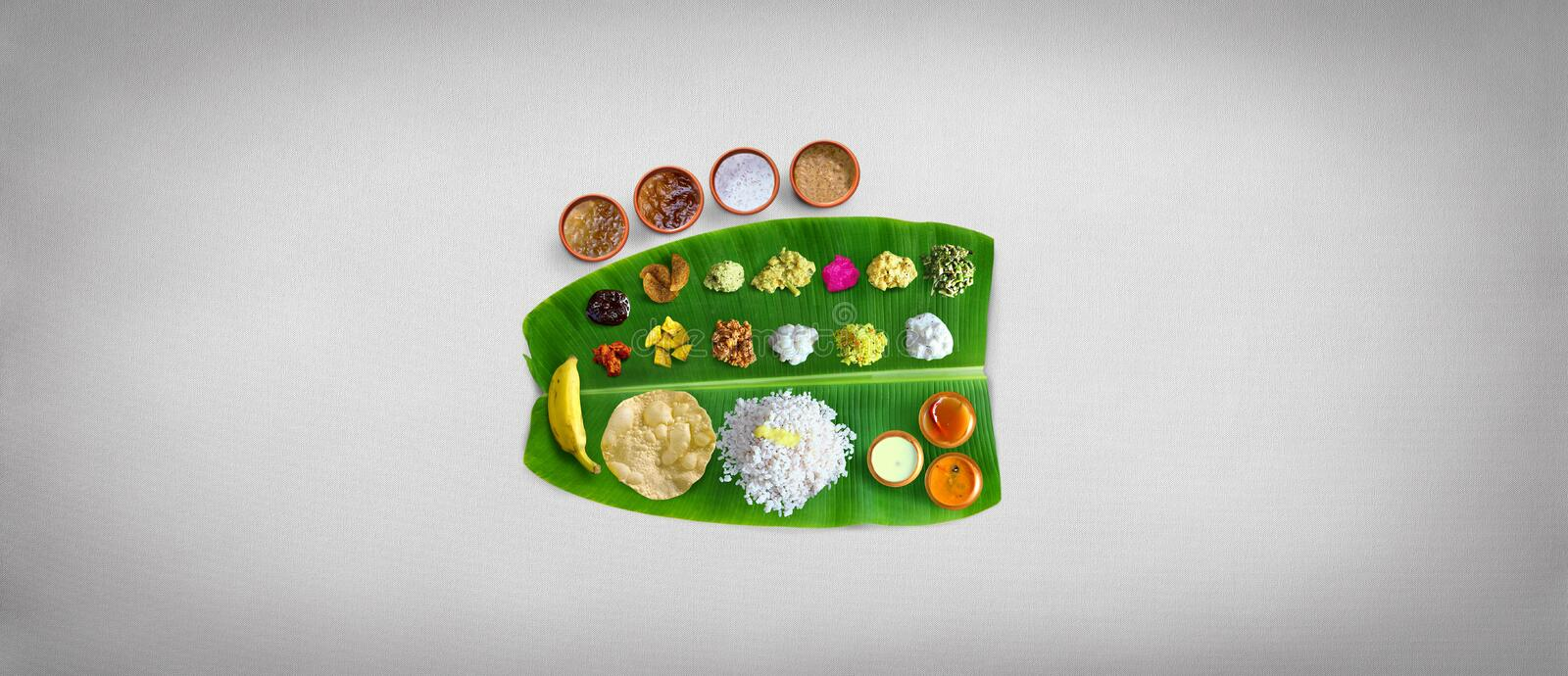 Traditional food Onam Sadya served on a banana leaf on Festival day onam,  Vegetarian meal with rice and curries, kerala food, Ker. Ala, india stock photo
